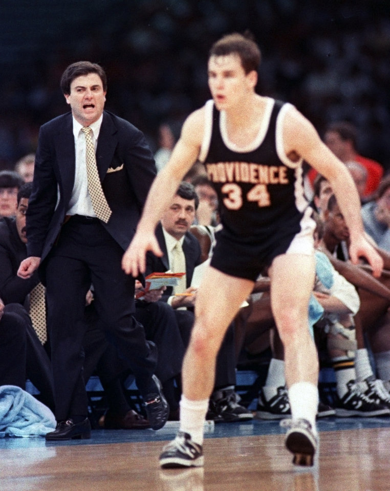 Photo -  Providence coach Rick Pitino, left, shouts instructions to Billy Donovan as the Friars fall behind Syracuse during the 1987 NCAA national semifinals in New Orleans. [AP photo]