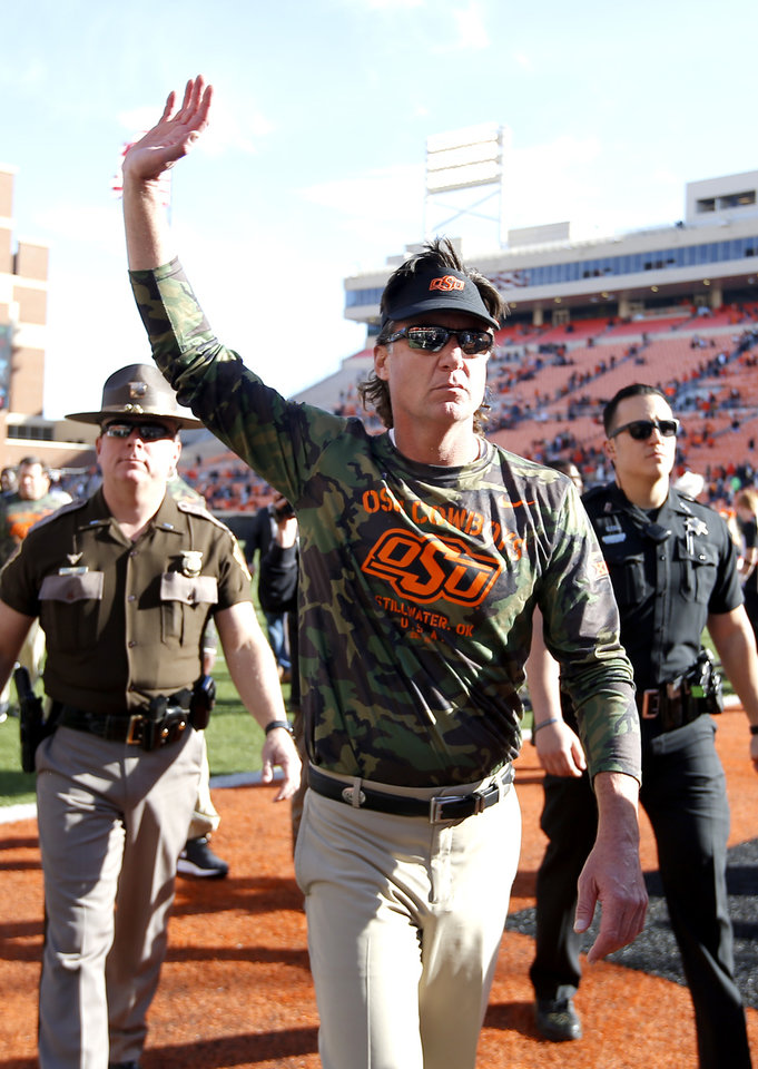 Photo - Oklahoma State head coach Mike Gundy waves to faves following the college football game between the Oklahoma State University Cowboys and the Kansas Jayhawks at Boone Pickens Stadium in Stillwater, Okla., Saturday, Nov. 16, 2019. OSU won 31-13. [Sarah Phipps/The Oklahoman]
