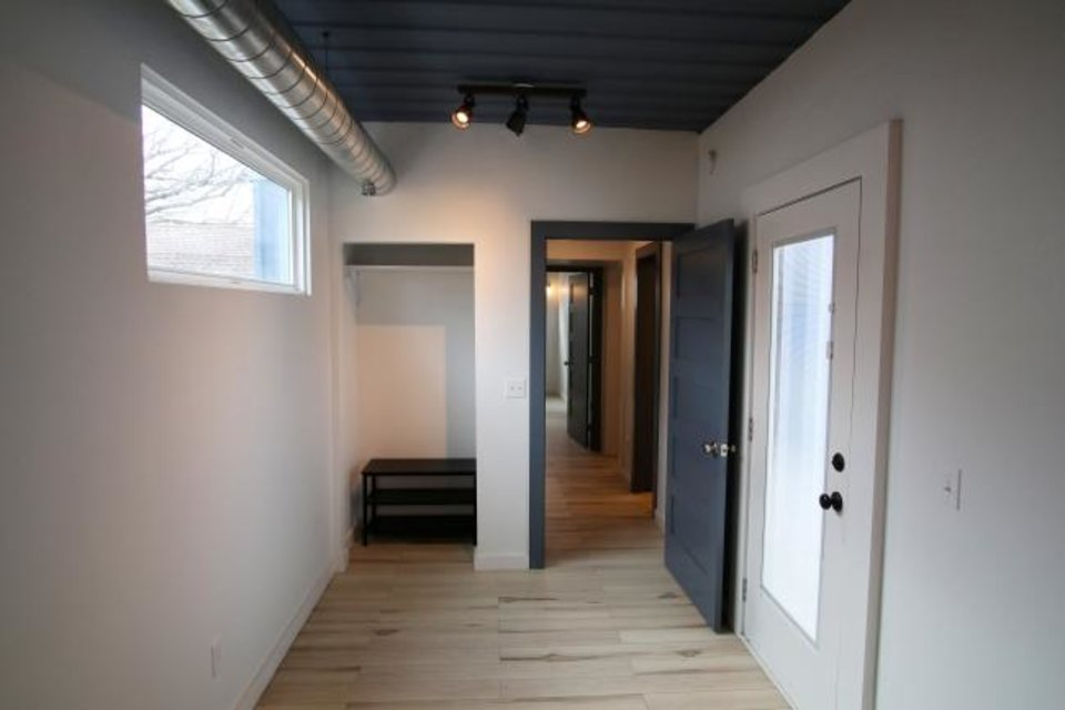 Photo -  A view down the hallway of the container house. [DOUG HOKE/THE OKLAHOMAN]