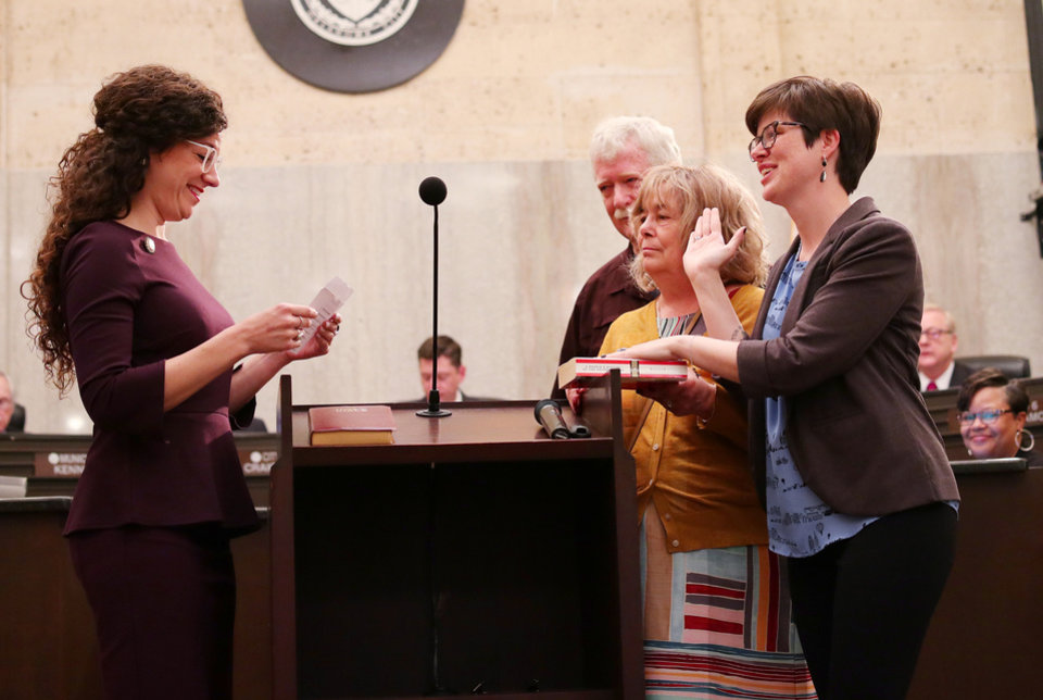 Photo - Carrie Blumert, Dist. 1 County Commissioner, swears in JoBeth Hamon, ward 6, with her parents, Brad and Beta Hamon,  during the swearing in ceremony for the Oklahoma City Council, Tuesday, April 9, 2019.  Photo by Doug Hoke/The Oklahoman
