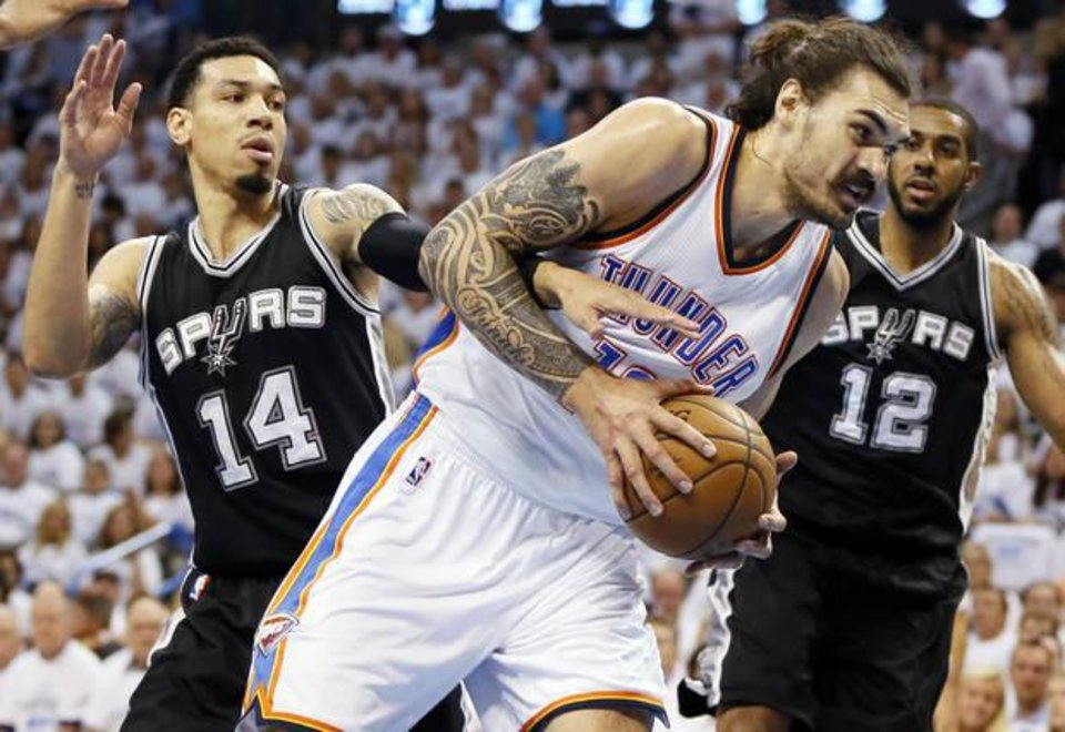 Photo - Steven Adams barrels past the Spurs' Danny Green and LaMarcus Aldridge in Game 4. (Photo by Nate Billings)