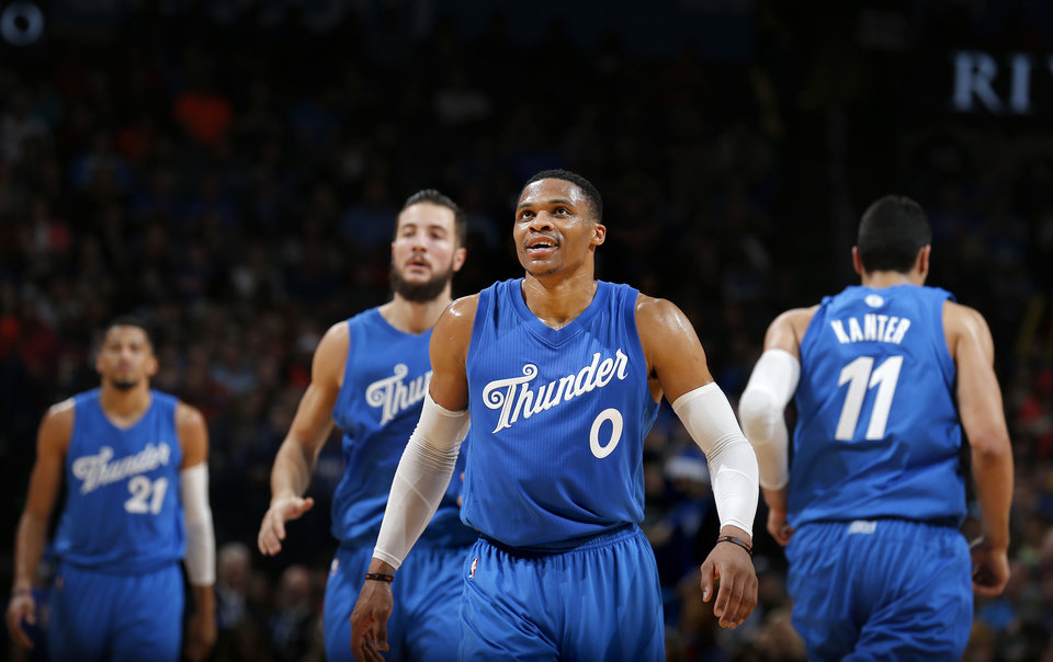 Photo - Oklahoma City's Russell Westbrook (0) walks off the court during the NBA game between the Oklahoma City Thunder and the Minnesota Timberwolves at the Chesapeake Energy Arena,  Sunday, Dec. 25, 2016. Photo by Sarah Phipps, The Oklahoman