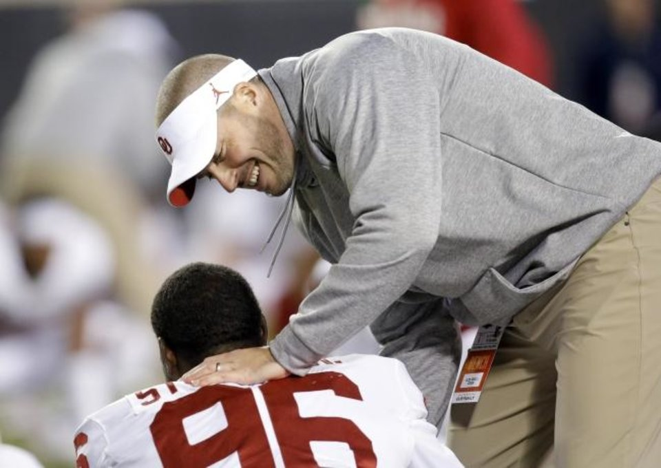Photo -  Oklahoma defensive coordinator/safeties Alex Grinch talks with Oklahoma's LaRon Stokes (96) before the Bedlam college football game between the Oklahoma State Cowboys (OSU) and Oklahoma Sooners (OU) at Boone Pickens Stadium in Stillwater, Okla., Saturday, Nov. 30, 2019. OU won  34-16. [Sarah Phipps/The Oklahoman]