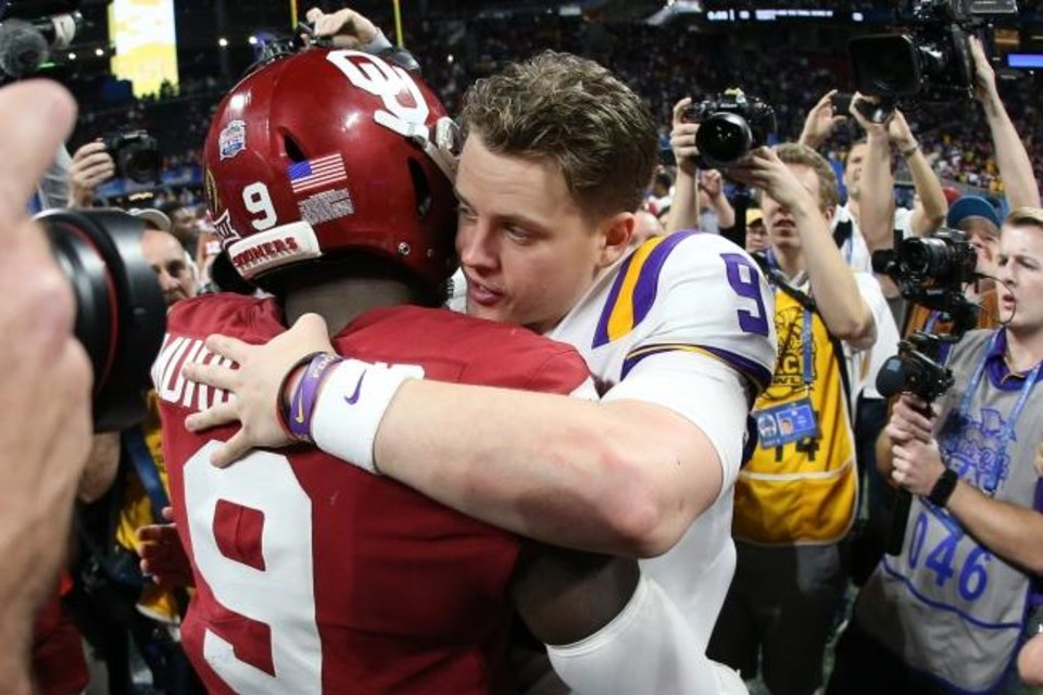 Photo -  LSU quarterback Joe Burrow, who throw seven touchdown passes Saturday, hugs OU linebacker Kenneth Murray after the Peach Bowl. [Brett Davis/USA TODAY Sports]