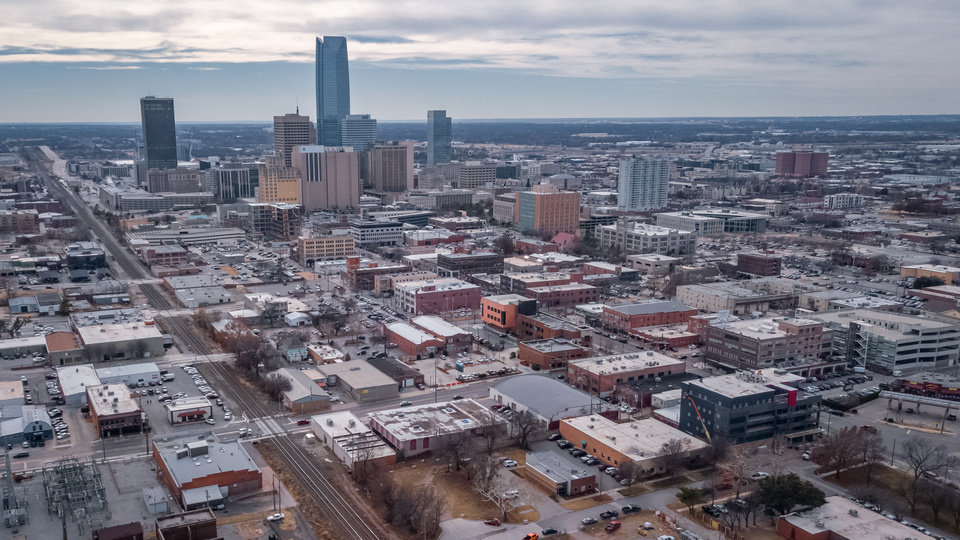 Photo - Drone image of Automobile Alley, Midtown and the OKC skyline. [Image by Dave Morris/The Oklahoman]