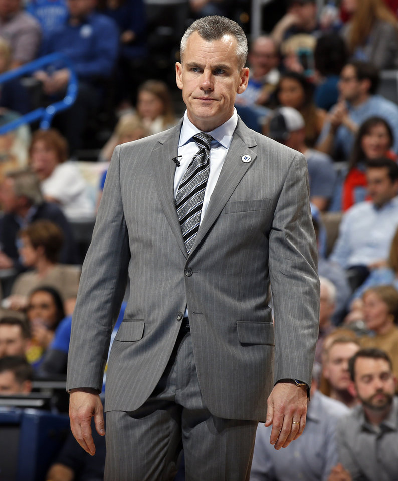 Photo - Oklahoma City head coach Billy Donovan walks on the court during a timeout in an NBA basketball game between the Oklahoma City Thunder and the Golden State Warriors at Chesapeake Energy Arena in Oklahoma City, Saturday, Feb. 27, 2016. Golden State won 121-118 in overtime. Photo by Nate Billings, The Oklahoman
