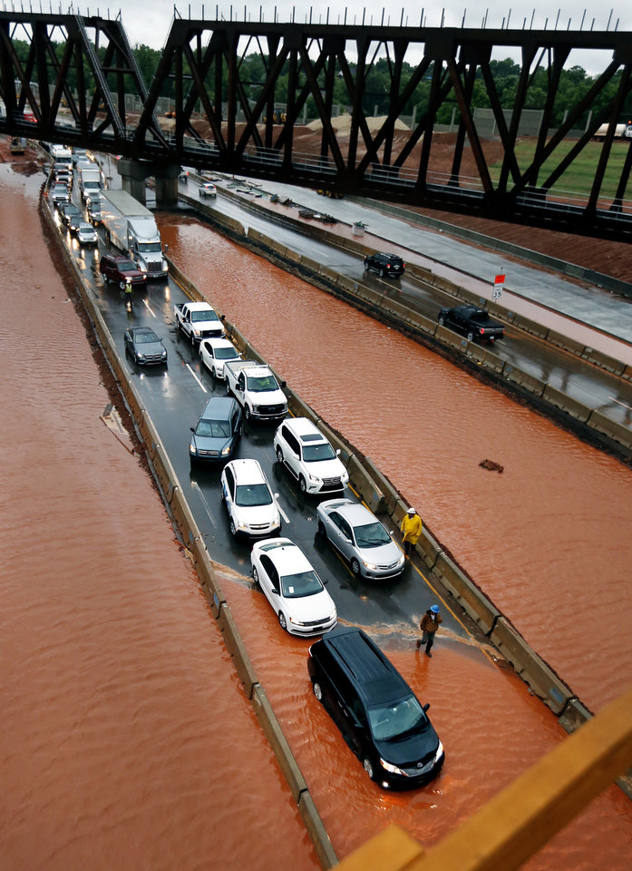 Photo -  Cars northbound on the Broadway Extension at NW 50 were stopped because of torrential rains Thursday. [Photo by Steve Sisney, The Oklahoman]