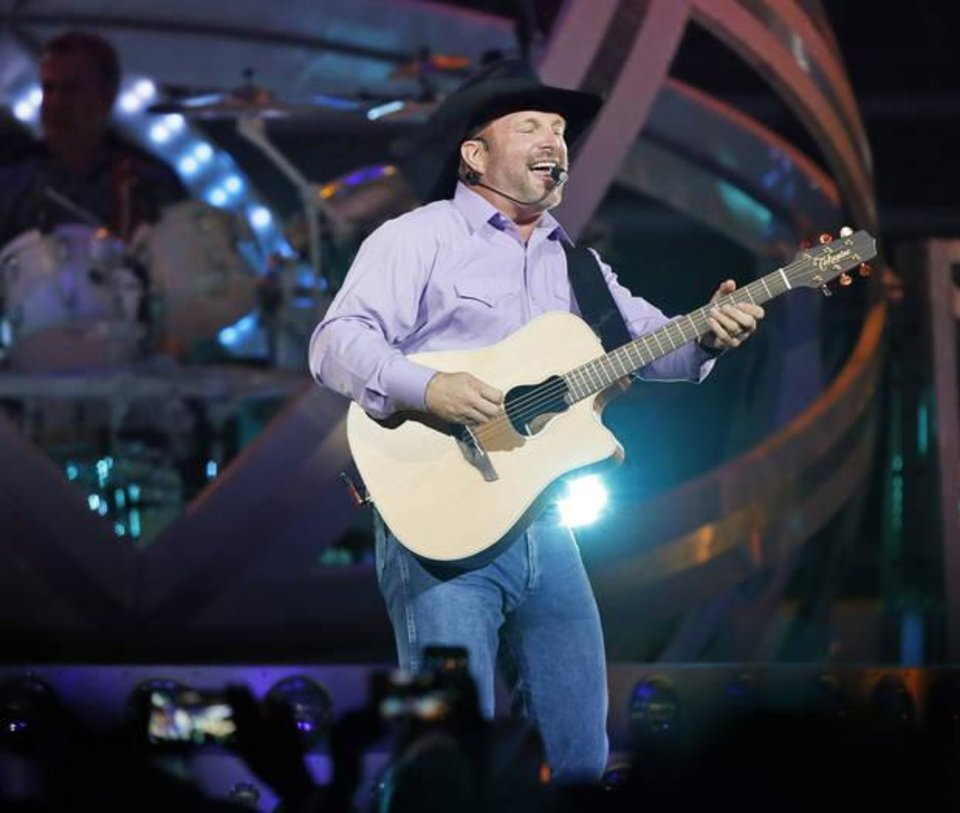 Photo -  Garth Brooks performs July 14 during his 7 p.m. show at the Chesapeake Energy Arena in Oklahoma City. [Photo by Nate Billings, The Oklahoman Archives]