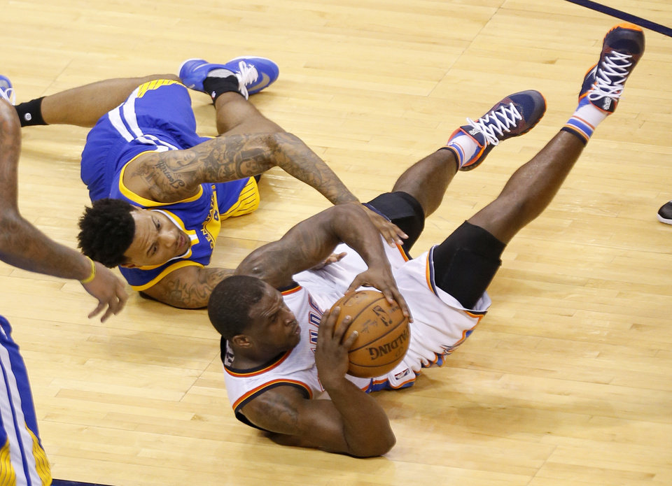 Photo - Oklahoma City's Dion Waiters (3) and Golden State 's Brandon Rush (4) wrestle for a loose ball during Game 3 of the Western Conference finals in the NBA playoffs between the Oklahoma City Thunder and the Golden State Warriors at Chesapeake Energy Arena in Oklahoma City, Sunday, May 22, 2016. Photo by Sarah Phipps, The Oklahoman
