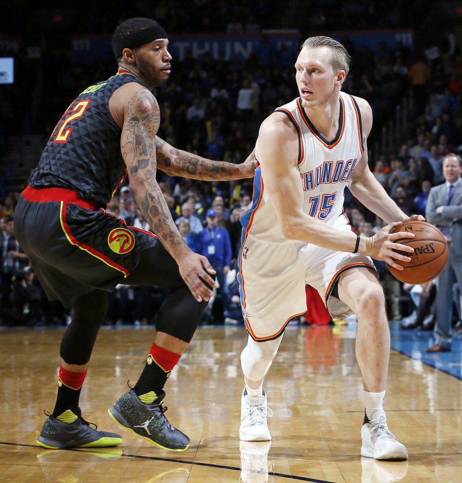 Photo - Stretching out the contract of Kyle Singler could lessen the Thunder's salary cap hit this season and the next. Photo by Nate Billings, The Oklahoman