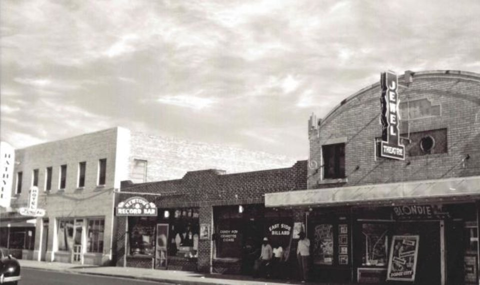 Photo -  The Jewel Theatre, at right, was one of a handful of cinemas that served the city's black population when Jim Crow laws limited the movement of people of color. [Provided]