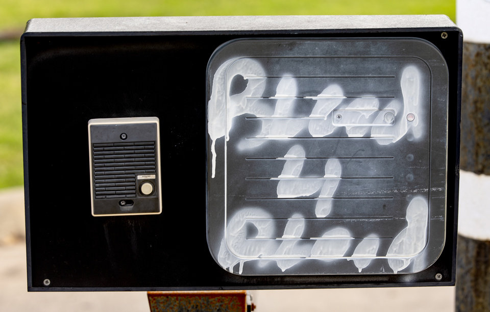 Photo - Graffiti left at the Oklahoma City Police Communication Center on Monday, June 1, 2020, in Oklahoma City, Okla. that was left behind from the George Floyd protest on Sunday.   [Chris Landsberger/The Oklahoman]