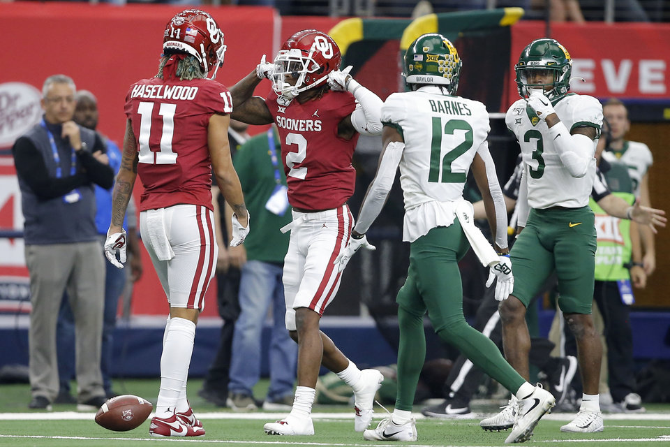Photo - Oklahoma's CeeDee Lamb (2) celebrates after a catch during the Big 12 Championship Game between the University of Oklahoma Sooners (OU) and the Baylor University Bears at AT&T Stadium in Arlington, Texas, Saturday, Dec. 7, 2019. Oklahoma won 30-23. [Bryan Terry/The Oklahoman]