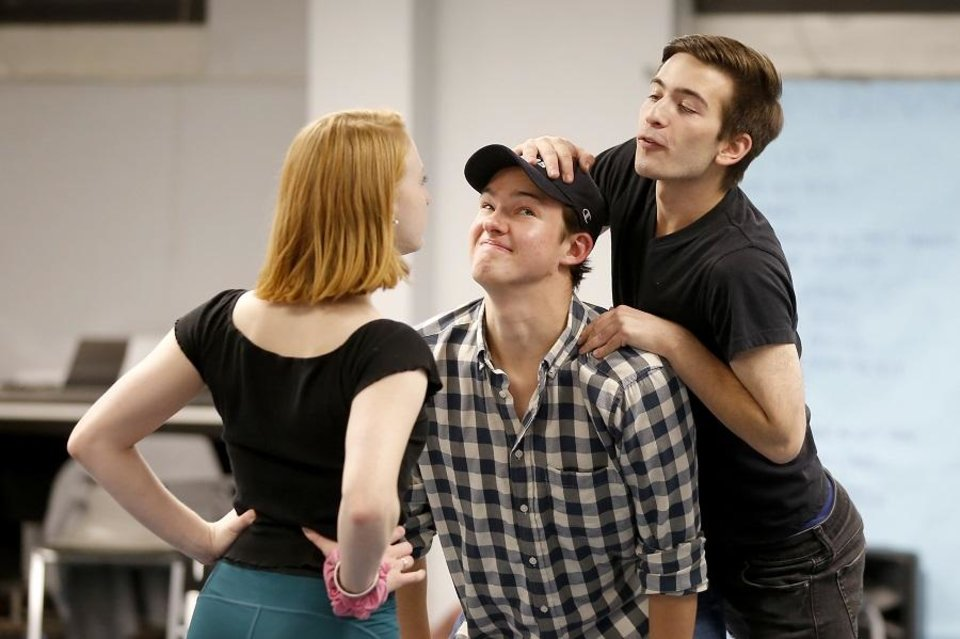Photo - Andrew Lewis, center, as Jem, Trevor Rau, as Dill, and Megan Berning, as Scout, rehearse for Oklahoma Children's Theatre and TheatreOCU's co-production of