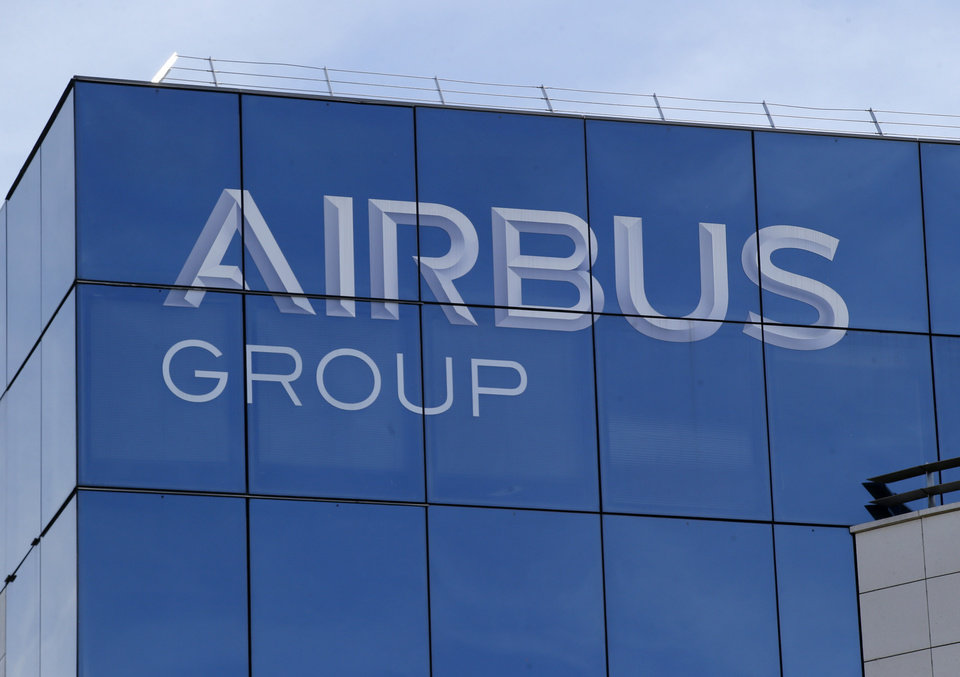 Photo -  FILE - In this May 6, 2016 file photo, the logo of the Airbus Group is pictured in Suresnes, outside Paris, France. European plane maker Airbus lost 1.1 billion euros ($1.3 billion) amid an unprecedented global slump in air travel because of the pandemic, but expects to deliver hundreds of planes and make a profit this year. (AP Photo/Michel Euler, File)