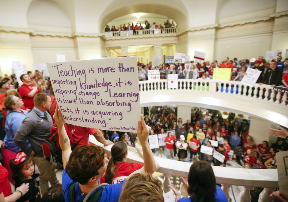Photo - Teachers and supporters of increased education funding fill the second floor rotunda of the state Capitol during the second day of a walkout by Oklahoma teachers, in Oklahoma City, Tuesday, April 3, 2018. Photo by Nate Billings, The Oklahoman