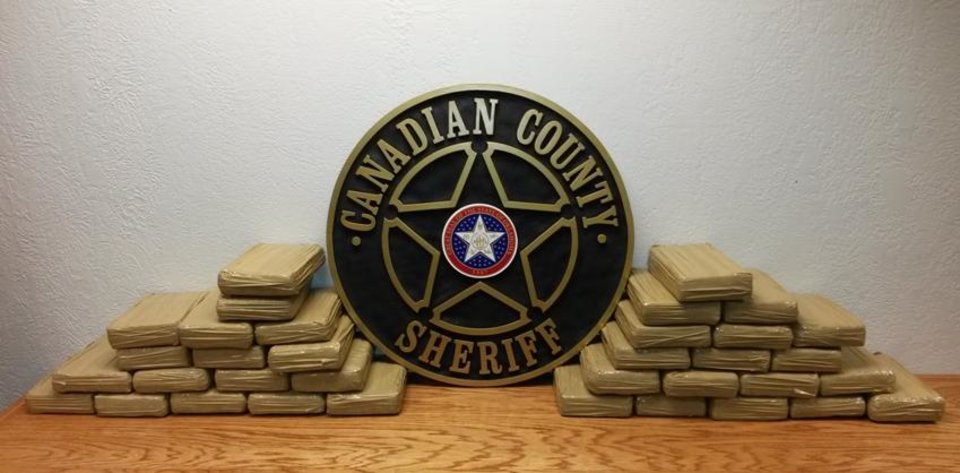 Photo -  This photo shows nearly 77 pounds of cocaine that were seized in January 2015 during a traffic stop on Interstate 40. [Photo provided by the Canadian County Sheriff's Office]