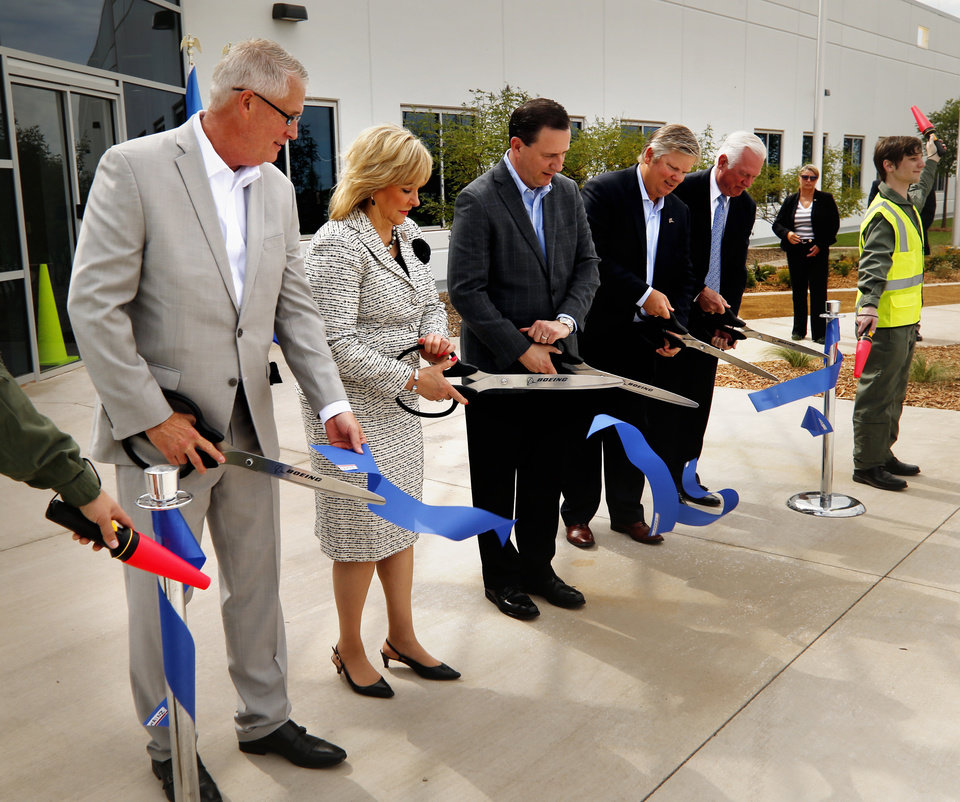 Photo -  Governor Mary Fallin, a supporter of Oklahoma's aerospace engineer tax credits, joins Boeing and Greater Oklahoma City Chamber officials to dedicate a new Boeing laboratory near Tinker Air Force Base in July 2016. [PHOTO BY STEVE SISNEY, THE OKLAHOMAN ARCHIVES]