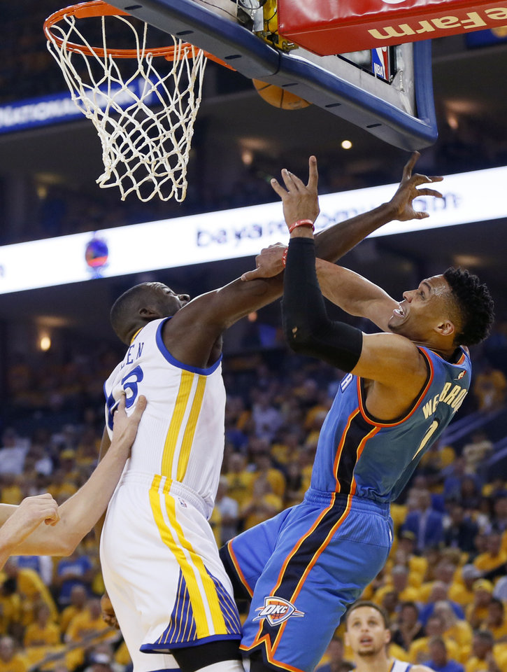 Photo - Golden State's Draymond Green (23) blocks the shot of Oklahoma City's Russell Westbrook (0) during Game 5 of the Western Conference finals in the NBA playoffs between the Oklahoma City Thunder and the Golden State Warriors at Oracle Arena in Oakland, Calif., Thursday, May 26, 2016. Photo by Nate Billings, The Oklahoman