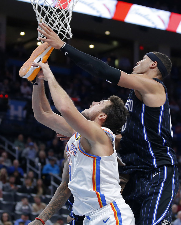 Photo - Oklahoma City's Danilo Gallinari (8) tries for a rebound while holding his shoe in front of Orlando's Aaron Gordon (00) during an NBA basketball game between the Oklahoma City Thunder and the Orlando Magic at Chesapeake Energy Arena in Oklahoma City, Tuesday, Nov. 5, 2019. Oklahoma City won 102-94. [Bryan Terry/The Oklahoman]