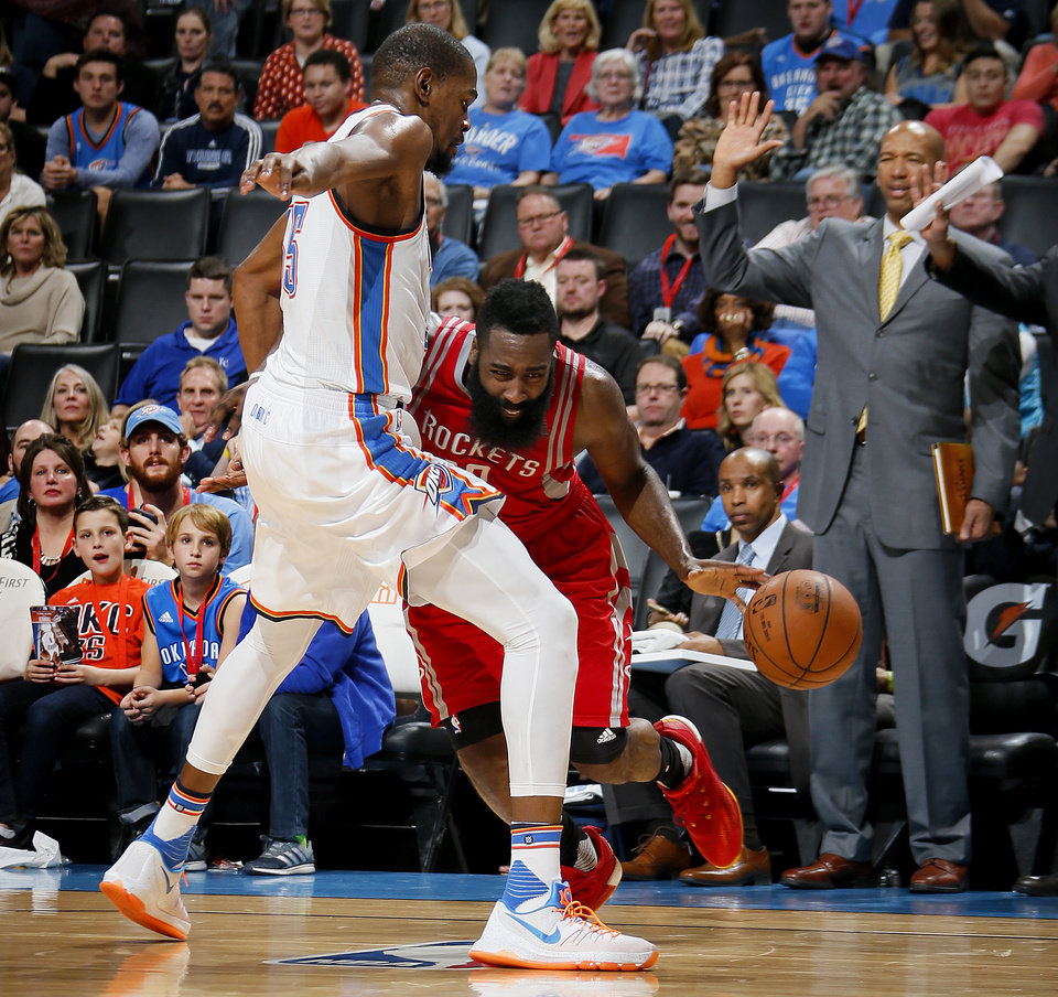 Photo - Oklahoma City's Kevin Durant (35) defends Houston's James Harden (13) during an NBA basketball game between the Oklahoma City Thunder and the Houston Rockets at Chesapeake Energy Arena in Oklahoma City, Friday, Jan. 29, 2016. Oklahoma City won 116-108. Photo by Bryan Terry, The Oklahoman