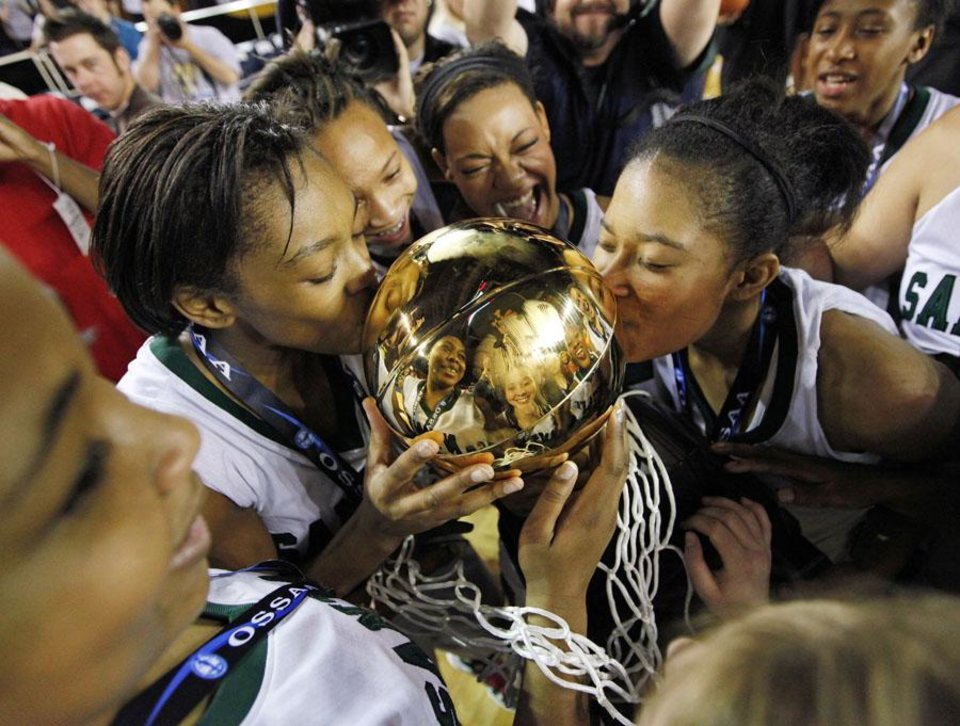 Photo -  GIRLS HIGH SCHOOL BASKETBALL / STATE TOURNAMENT: Courtney Walker (23), left, and Tamara Lee (20), right, of Edmond Santa Fe kiss the gold ball trophy after the Class 6A girls basketball state championship game between Edmond Santa Fe and Midwest City at the Mabee Center in Tulsa, Okla., Saturday, March 12, 2011. Edmond Santa Fe won, 56-36. Photo by Nate Billings, The Oklahoman ORG XMIT: KOD