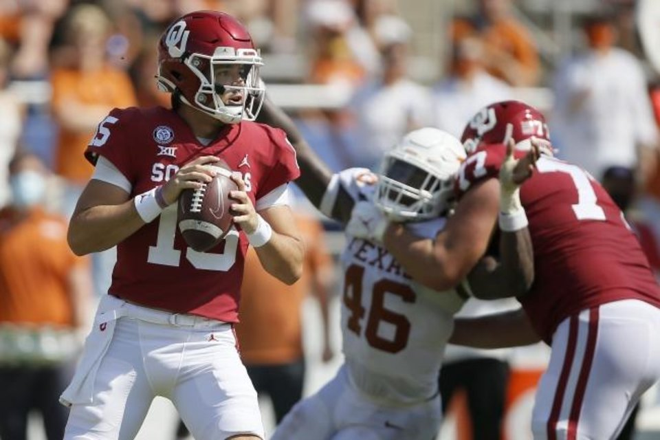 Photo -  Oklahoma's Tanner Mordecai (15) drops back to pass against Texas on Oct. 10 in Dallas. [Bryan Terry/The Oklahoman]