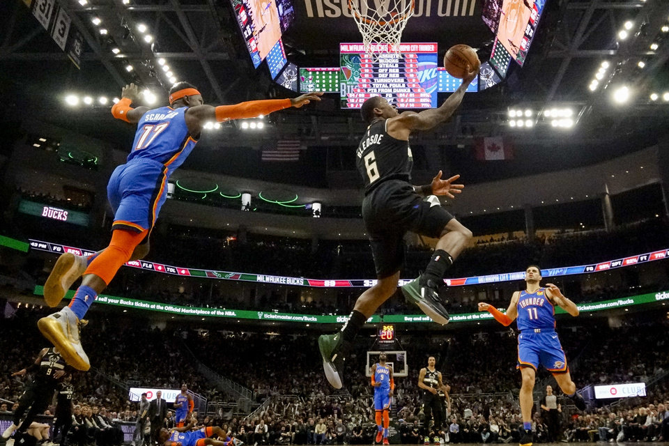 Photo - Milwaukee Bucks' Eric Bledsoe shoots past Oklahoma City Thunder's Dennis Schroder during the second half of an NBA basketball game Friday, Feb. 28, 2020, in Milwaukee. (AP Photo/Morry Gash)