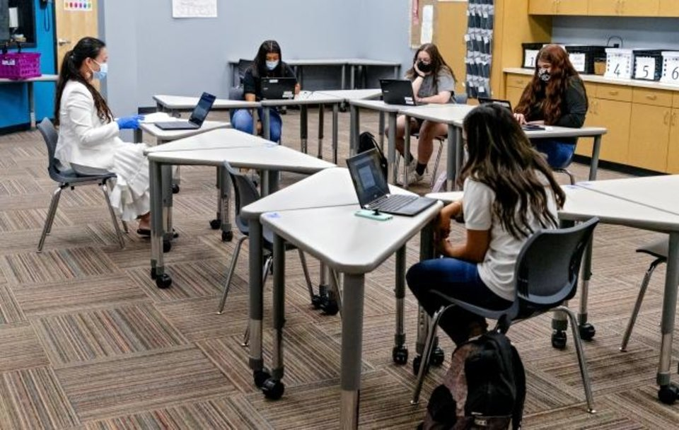 Photo -  Students take part in a reduced-size class at Santa Fe South High School in Oklahoma City on Wednesday. Santa Fe South Schools was among the first districts to reopen face-to-face in the Oklahoma City metro area for the 2020-21 school year. The charter school district had 25% of the students at each school return in person on Tuesday.  [Chris Landsberger/The Oklahoman]