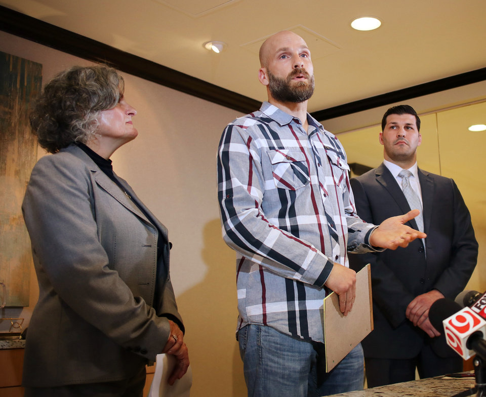 Photo - Vicki, Michael and Brett Behenna at a family press conference for the Presidential Pardon Michael Behenna received Monday, in downtown Oklahoma City, Wednesday, May 8, 2019.  Photo by Doug Hoke.
