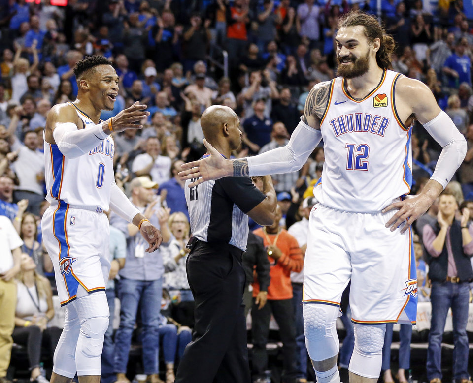 Photo - Oklahoma City's Russell Westbrook (0), left, and Steven Adams (12) slap hands after a dunk by Adams with an assist from Westbrook in the third quarter during an NBA basketball game between the Detroit Pistons and the Oklahoma City Thunder at Chesapeake Energy Arena in Oklahoma City, Friday, April 5, 2019. Oklahoma City won 123-110. Photo by Nate Billings, The Oklahoman