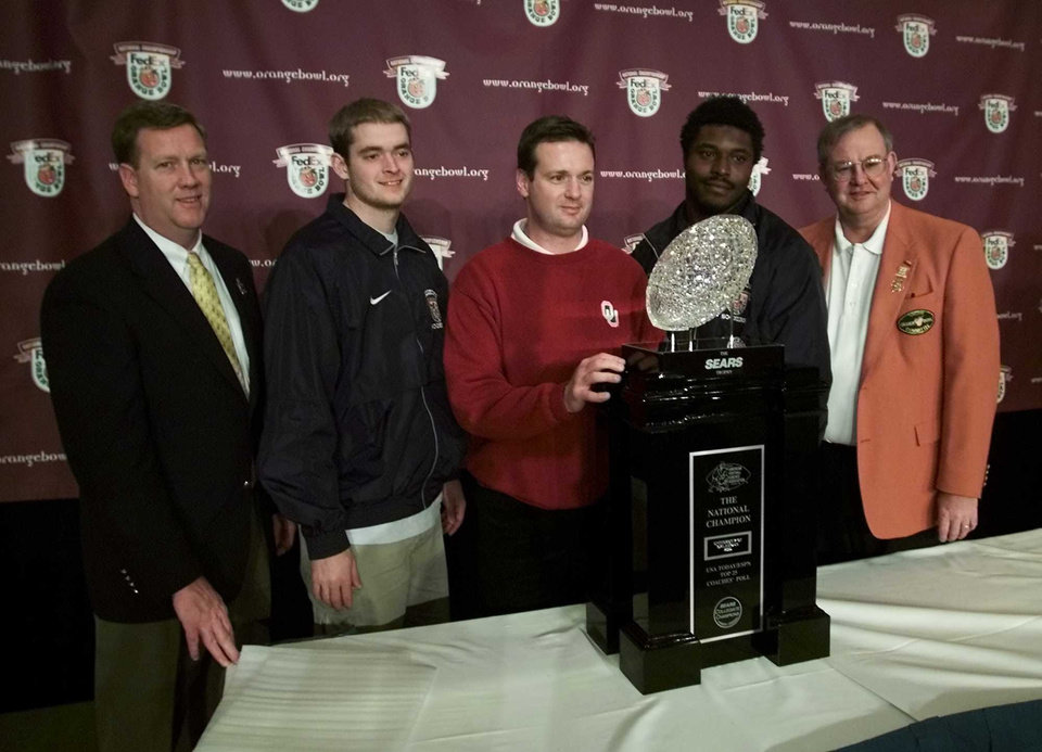 Photo - NATIONAL CHAMPIONSHIP, COLLEGE FOOTBALL: OU FLORIDA STATE ORANGE BOWL:  Kevin Keleghan, President Credit Services with Sears, Roebuck and Co, Josh Heupel, OU head coach Bob Stoops, Torrance Marshall and Sherill Hudson, president of the Orange Bowl Committee pose with the BCS National championship trophy at a press conference the day after the Sooners defeated the Florida State Seminoles in the Orange Bowl.  Staff Photo by Steve Sisney