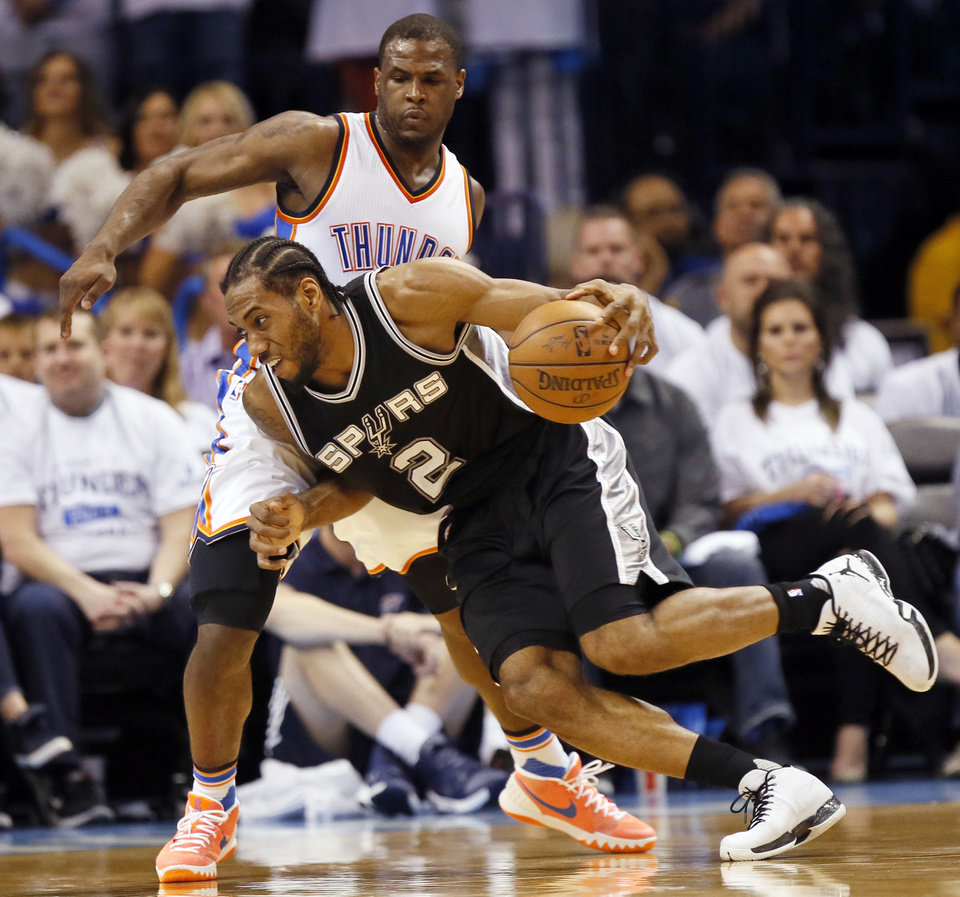 Photo - San Antonio's Kawhi Leonard (2) drives against Oklahoma City's Dion Waiters (3) during Game 4 of the Western Conference semifinals between the Oklahoma City Thunder and the San Antonio Spurs in the NBA playoffs at Chesapeake Energy Arena in Oklahoma City, Sunday, May 8, 2016. Photo by Nate Billings, The Oklahoman