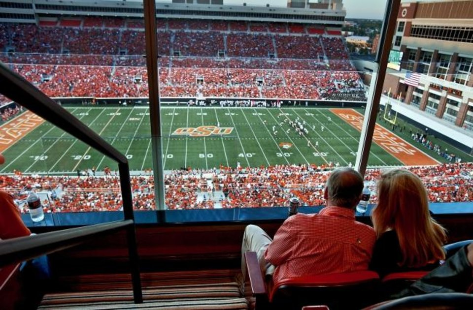 Photo -  Boone Pickens and then-wife Madeleine watch OSU play Grambling State from a suite at Boone Pickens Stadium on Sept. 26, 2009. [Chris Landsberger/Oklahoman archives]