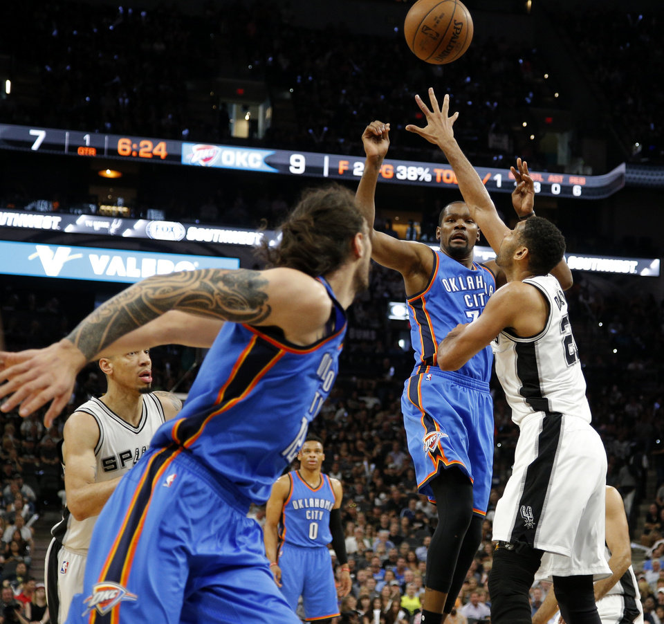 Photo - Oklahoma City's Kevin Durant (35) passes over San Antonio's Tim Duncan (21) to Steven Adams (12) during Game 5 of the second-round series between the Oklahoma City Thunder and the San Antonio Spurs in the NBA playoffs at the AT&T Center in San Antonio, Tuesday, May 10, 2016. Photo by Bryan Terry, The Oklahoman