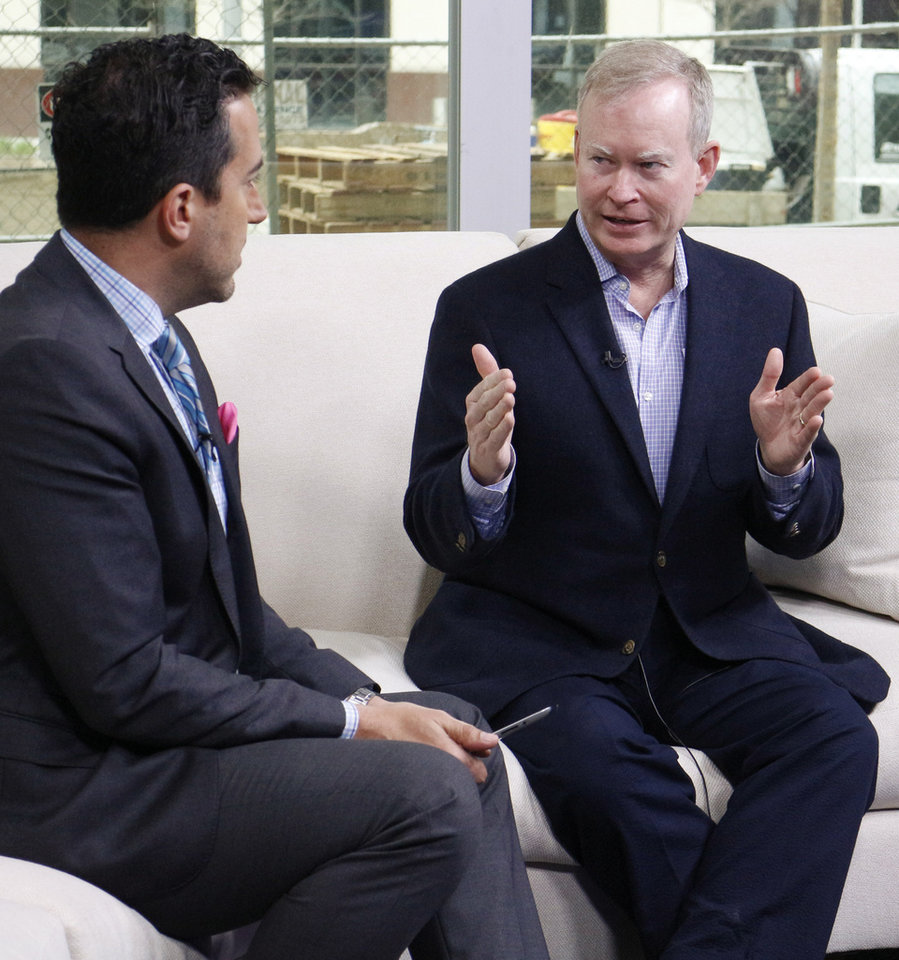 Photo - Mayor Mick Cornett is interviewed by David Morris on his movie about Oklahoma City Friday April 3, 2015. Photo by Doug Hoke, The Oklahoman.