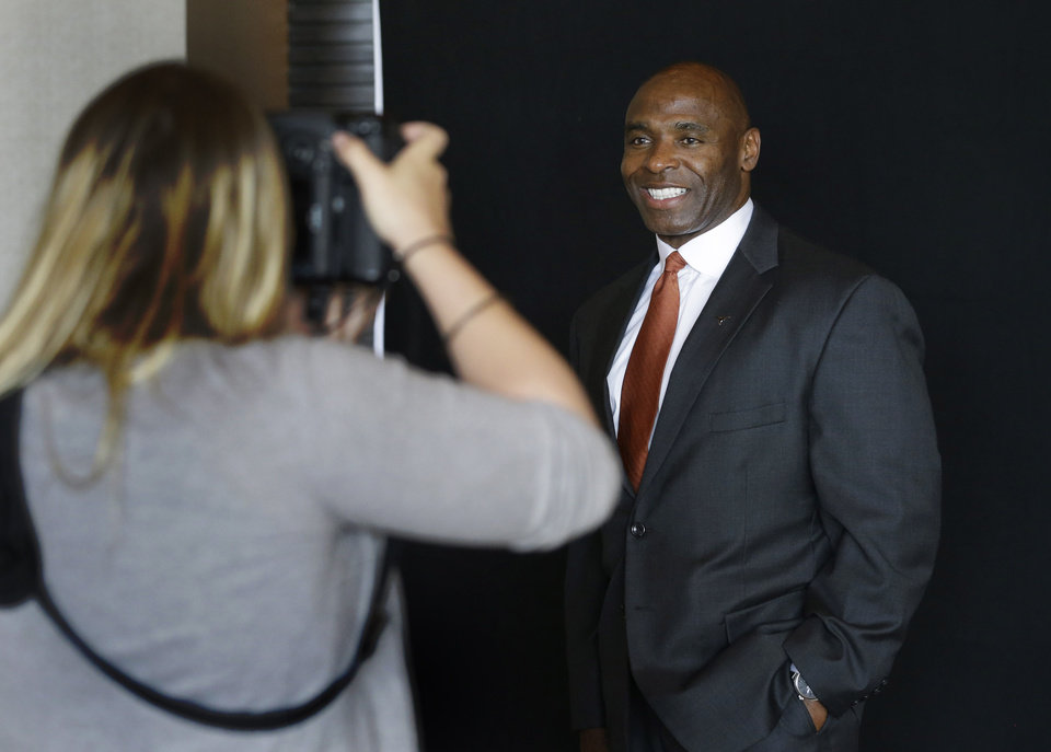 Photo - Texas coach Charlie Strong poses for a portrait at the Big 12 Conference NCAA college football media days in Dallas, Tuesday, July 22, 2014. (AP Photo)