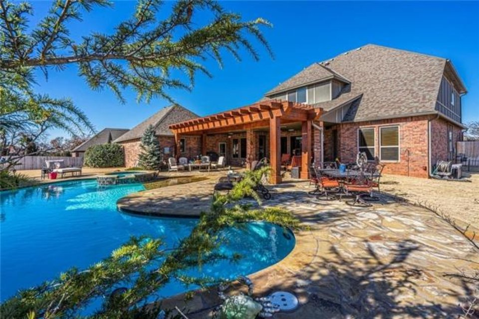 Photo -  Back and pool at 1400 Autumn Creek Drive, Edmond, the Listing of the Week. [PHOTO PROVIDED]