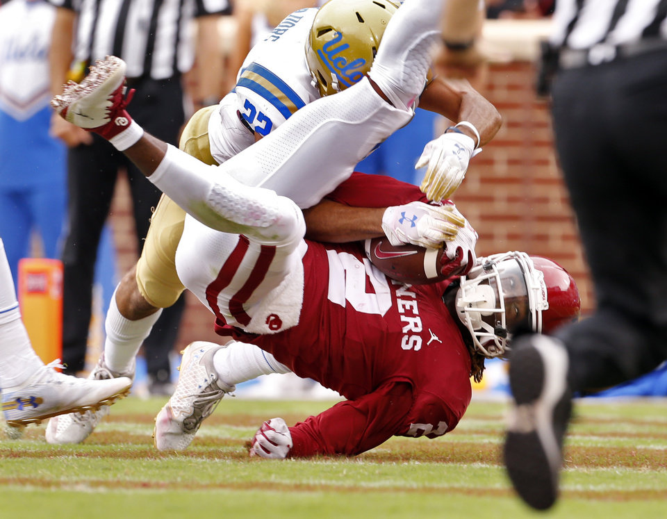 4c6c3fbae Oklahoma s CeeDee Lamb catches a 35-yard touchdown pass early in the fourth  quarter against UCLA s Nate Meadors.  Photo by Steve Sisney