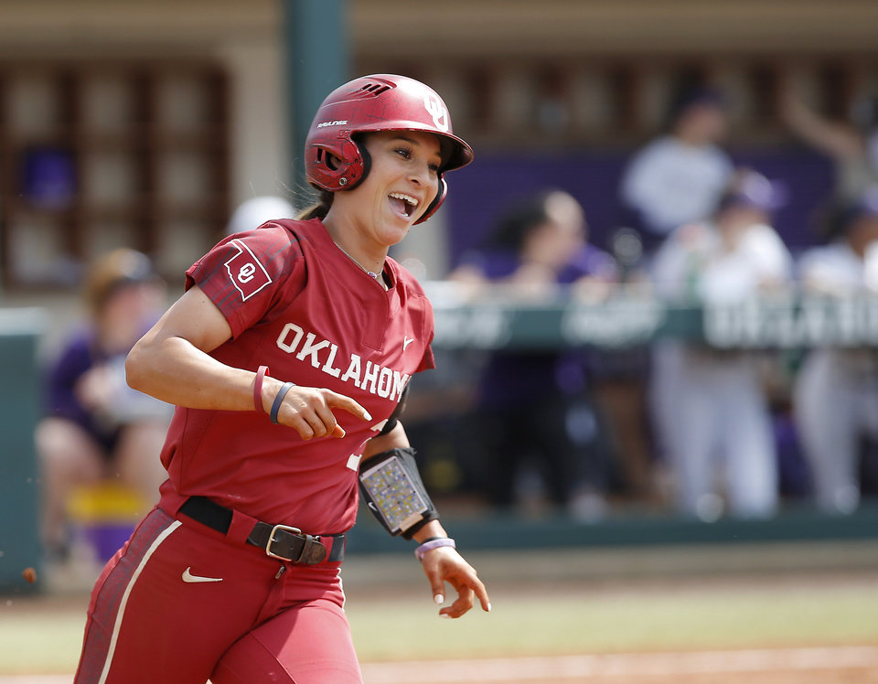 Photo - Oklahoma's Sydney Romero (2) celebrates after hitting a home run in the third inning of the second softball game in the Norman Super Regional between the University of Oklahoma (OU) and Northwestern in Norman, Okla., Saturday, May 25, 2019. Oklahoma won 8-0 to send them to the Women's College World Series. [Bryan Terry/The Oklahoman]