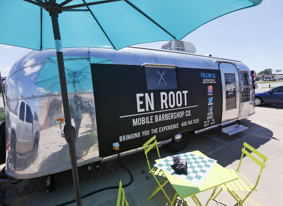 Photo -  En Root is a mobile barber shop inside an Airstream trailer that Bruce Waight Sr. and his partner, Vanessa Morrison, acquired and remodeled with the help of friends and relatives. [Photo by Nate Billings, The Oklahoman]