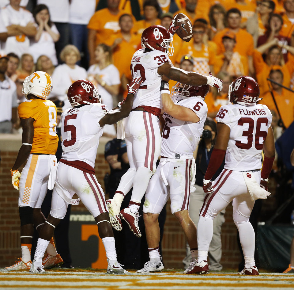 Photo - From left, Tennessee's Justin Martin (8) walks away as Oklahoma's Durron Neal (5), Samaje Perine (32), Baker Mayfield (6) and Dimitri Flowers (36) celebrate a touchdown pass from Mayfield to Perine in the fourth quarter of the college football game between the Oklahoma Sooners (OU) and the Tennessee Volunteers at Neyland Stadium in Knoxville, Tennessee, Saturday, Sept. 12, 2015. OU won 31-24 in double overtime. Photo by Nate Billings, The Oklahoman