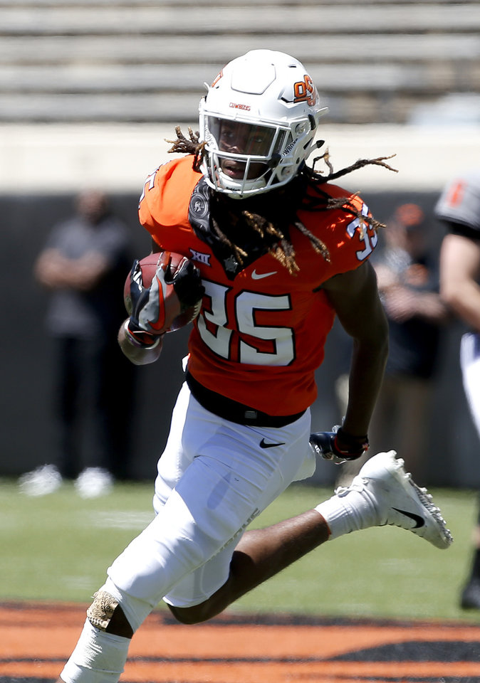 Photo - Oklahoma State's C.J. Moore (35) runs after a catch during the Oklahoma State Cowboys spring practice at Boone Pickens Stadium in Stillwater, Okla., Saturday, April 20, 2019.  Photo by Sarah Phipps, The Oklahoman