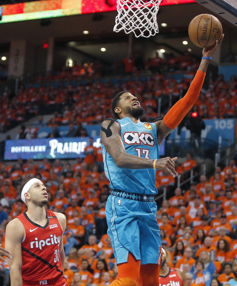 Photo - Oklahoma City's Paul George (13) goes to the basket past Portland's Seth Curry (31) during Game 3 in the first round of the NBA playoffs between the Portland Trail Blazers and the Oklahoma City Thunder at Chesapeake Energy Arena in Oklahoma City, Friday, April 19, 2019. Photo by Bryan Terry, The Oklahoman