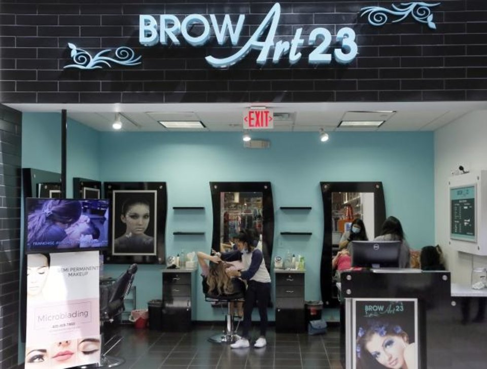 Photo -  Brow Art 23 is one of the businesses open Friday at Penn Square Mall. [Nate Billings/The Oklahoman]