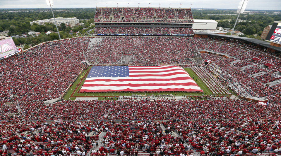 Photo - ROTC members unfurl a 70 yard long United States Flag before a college football game between the University of Oklahoma Sooners (OU) and the Army Black Knights at Gaylord Family-Oklahoma Memorial Stadium in Norman, Okla., on Saturday, Sept. 22, 2018. Photo by Steve Sisney, The Oklahoman