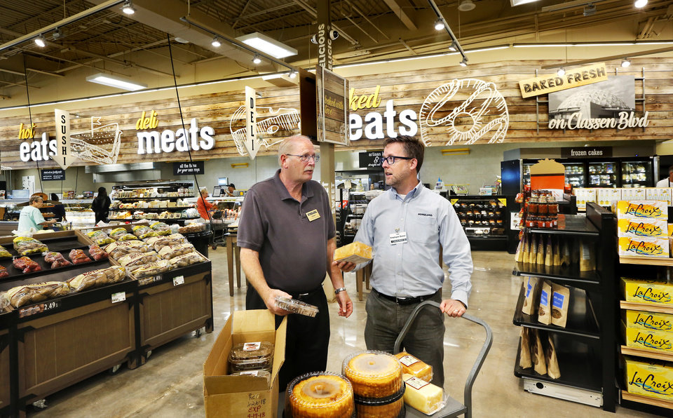 Photo -  Dennis Kluding, left, store manager, and Marc Jones, CEO of Homeland, visit inside the remodeled Homeland Store at NW 18 and Classen. [Photo by Jim Beckel, The Oklahoman]