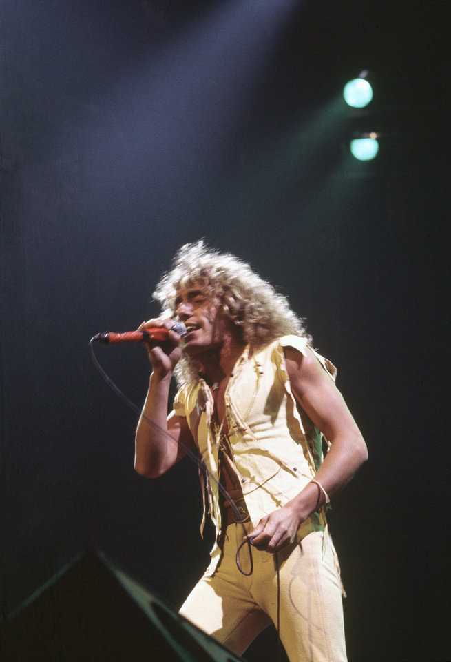 Photo -  Roger Daltrey, lead singer of the Who is shown performing in New York's Madison Square Garden, March 11, 1976. (AP Photo/Alan Tepper)