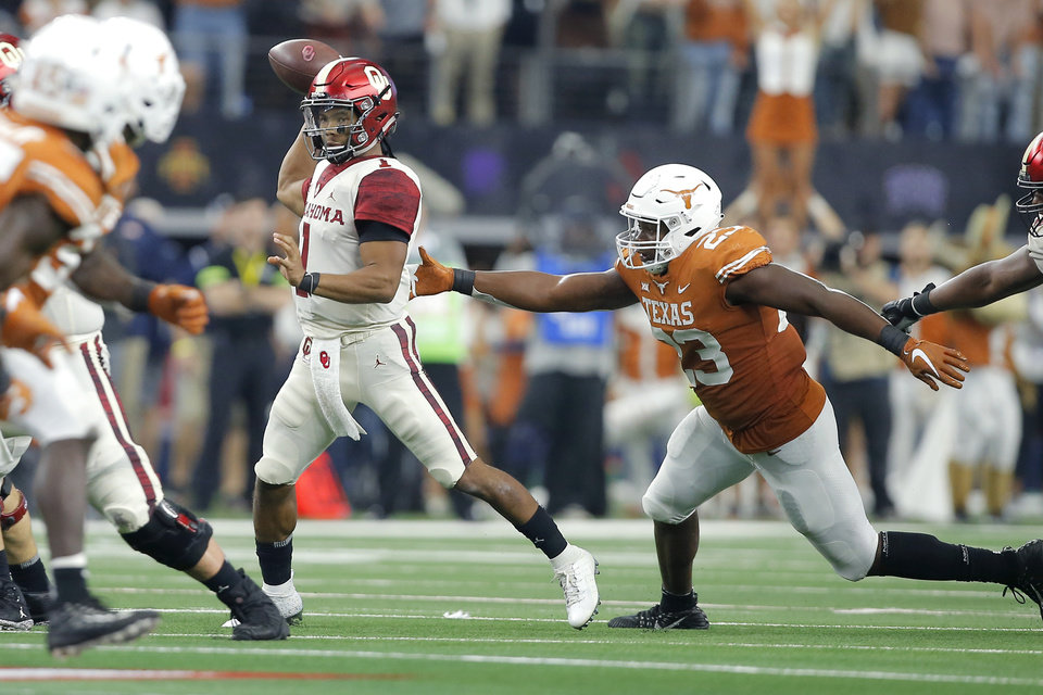Photo - Oklahoma's Kyler Murray (1) throws a pass as Jeffrey McCulloch (23) of Texas chases during the Big 12 Championship football game between the Oklahoma Sooners (OU) and the Texas Longhorns (UT) at AT&T Stadium in Arlington, Texas, Saturday, Dec. 1, 2018.  Oklahoma won 39-27. Photo by Bryan Terry, The Oklahoman