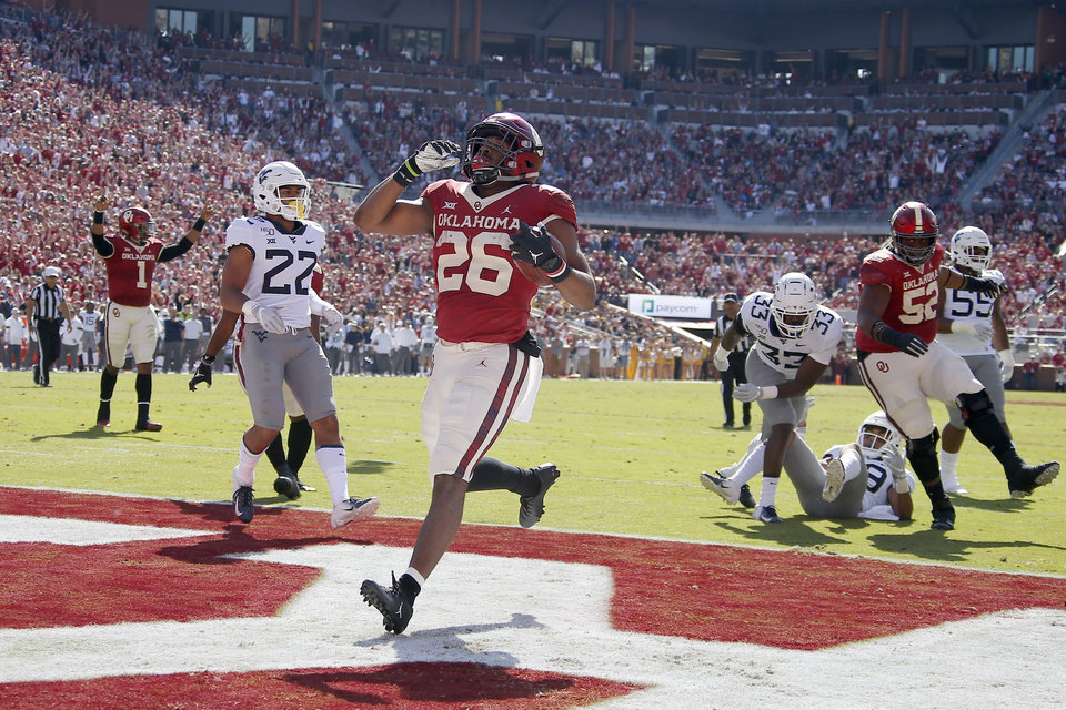 Photo - Oklahoma's Kennedy Brooks (26) scores a touchdown during a college football game between the University of Oklahoma Sooners (OU) and the West Virginia Mountaineers at Gaylord Family-Oklahoma Memorial Stadium in Norman, Okla, Saturday, Oct. 19, 2019. Oklahoma won 52-14. [Bryan Terry/The Oklahoman]